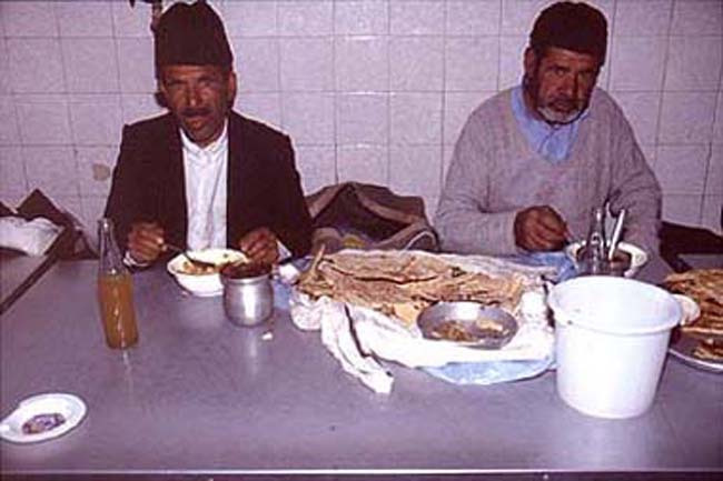 Old men_tucking into abgusht in Iran
