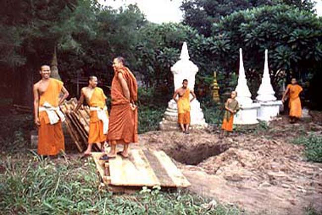 Monk chain gang in Vientiane, Laos