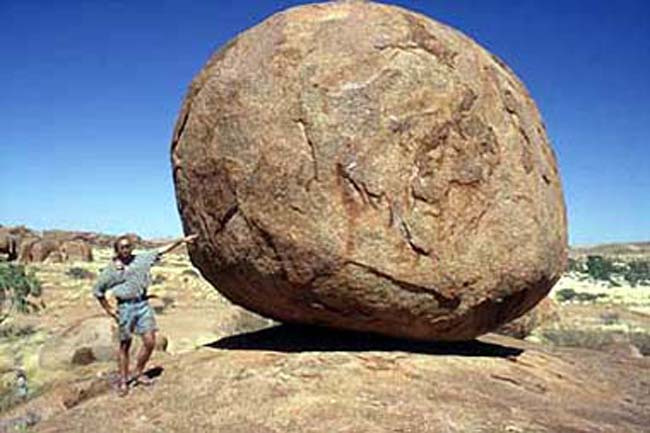 Holding up a Devil's Marble in the Northern Territory, Australia