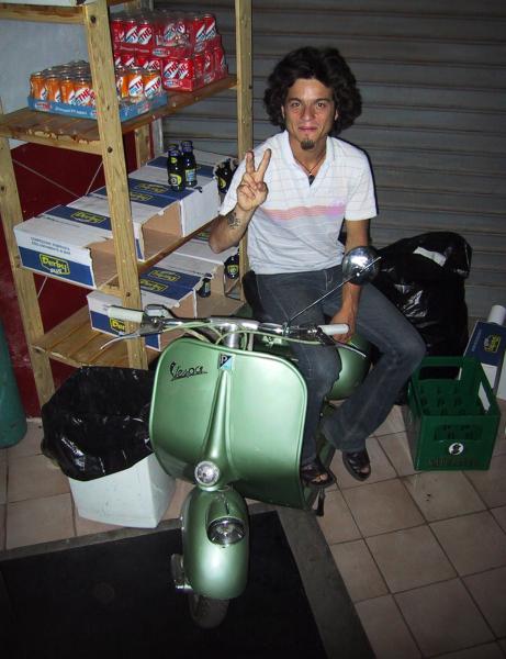 Federico with his Vespa the Pub dei Fantasmi storeroom